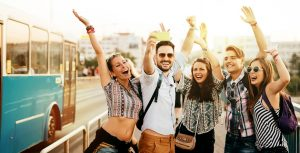 Cheerful friends travelling, taking selfies and smiling